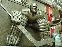 The larger-than-life statue honouring Ken Danby's 'At The Crease' painting outside the Spirit of Hockey Store