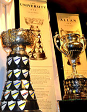 The University Cup and Allen Cup are two of  celebrated trophies featured in the Hometown Hockey exhibit.