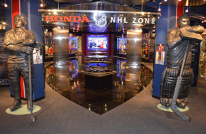 Statues of Cyclone Taylor and Ken Dryden welcome guests to the NHL Legends section within the Honda NHL Zone.