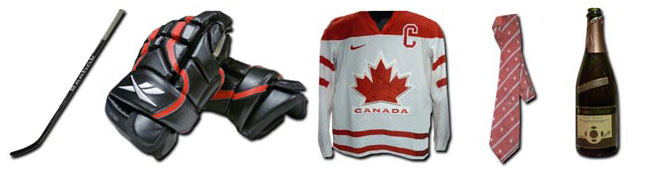 The 'Double Gold' exhibit features the most prized artifacts from canada's Men's and Women's 2010 Olympic Hockey triumphs, including: the gloves and sticks used by Sidney Crosby, celebratory champagne bottles, jersey worn by captain Haley Wickenheiser, and tie worn by coach Mike Babcock.