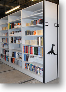 The D.K. Doc Seaman Hockey Resource Centre's Artifact Storage Area has revolving high density shelving that creates an efficient method for Resource Centre staff to retrieve relevant materials for any hockey project.