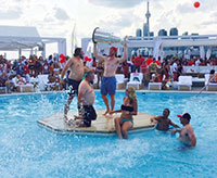 Bickell and the Stanley Cup celebrate Canada Day with some friends at a pool party in Toronto, Ontario.