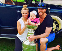 Bryan, Amanda and Makayla Bickell pose for a family photo with the Stanley Cup.