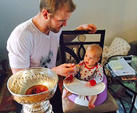 In Newtonville, Ontario, Bryan Bickell feeds daughter, Makayla from the Stanley Cup.