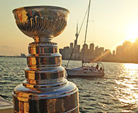 The Stanley Cup cruising Lake Ontario with the Toronto skyline in the background.