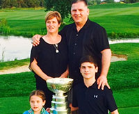 The Bernard family pose for a photo with the Stanley Cup on the 18th green at Willow Valley Golf Club