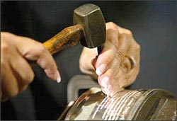 For twenty one years, the hands of Louise St. Jacques have methodically engraved the names of every Stanley Cup champion into Lord Stanley's Cup.