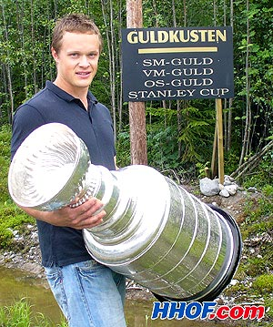 Anaheim Ducks centre Samuel Pahlssson poses with the Stanley Cup at his summer home in Sweden