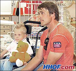 Teemu Selanne visits with young patients at the Helsinki Children's Hospital