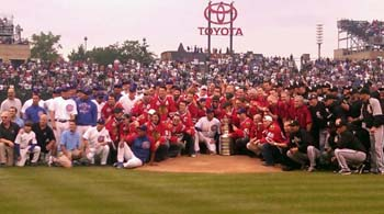Members of the Hawks, Cubs and White Sox pose for a group photo with the Stanley Cup.