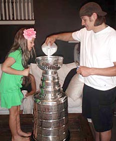 Brent Sopel and family about to enjoy some cereal from the bowl of the Stanley Cup
