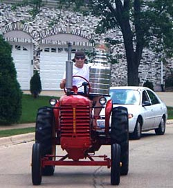 Brent Sopel and the Stanley Cup out for a drive through the streets of Hinsdale on his restored family tractor