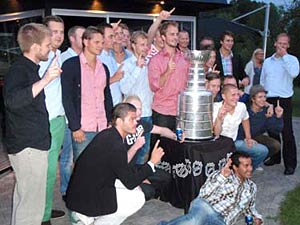 Niklas Hjalmarsson  and some of his former teammates getting their picture taken with Lord Stanley