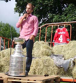 Niklas Hjalmarsson speaks to the crowd during his day with the Stanley Cup in Russnas, Sweden.