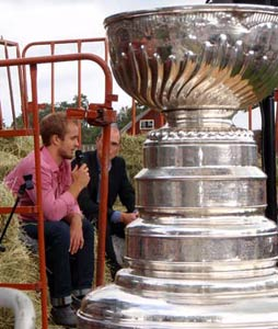 The Stanley Cup looks on as Niklas Hjalmarsson answers questions during his day with the Stanley Cup in Russnas, Sweden.