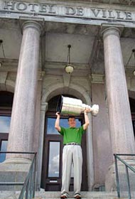 Stephane Waite and the Stanley Cup on the steps of City Hall