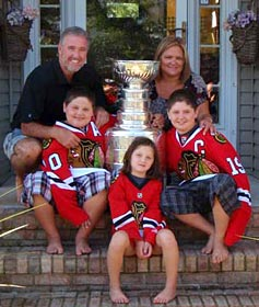 Mike Haviland and family sharing a moment with the Stanley Cup