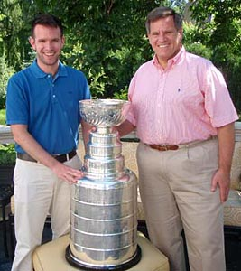 Rocky Wirtz sharing a moment with his son and the Stanley Cup