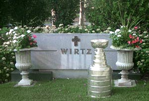 The Stanley Cup in front of the Wirtz family burial site