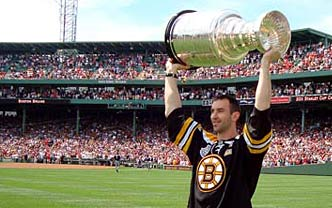 Zdeno Chara showing off the Stanley Cup at Fenway Park