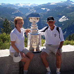 Boston Bruins owner Jeremy Jacobs and his wife Margaret sharing a moment with the Stanley Cup at Yosemite National Park.