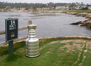 The Stanley Cup sits on the tee box of the 18th hole at Pebble Beach.