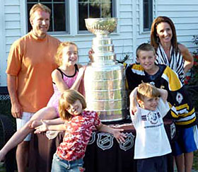 Geoff Ward and family sharing a moment with the Stanley Cup at their home