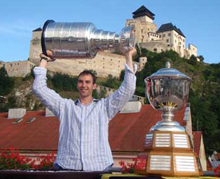 Zdeno Chara celebrating with the Stanley Cup and Norris Trophy at the Panorama Club in Trencin, Slovakia.