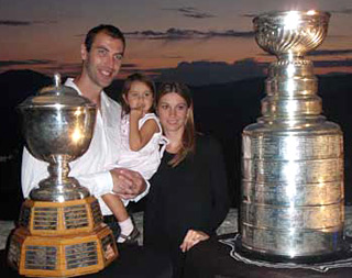 Zdeno Chara along with his wife Tatiana and their daughter Elliz sharing a moment with the Stanley Cup and Norris Trophy at the Trencin Castle.