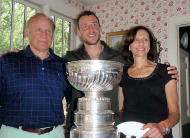 Gregory Campbell and his parents sharing a moment with the Stanley Cup.