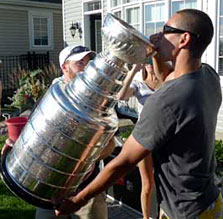 Chris Kelly takes a sip from the most famous trophy in all of sports.