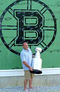 Peter Chiarelli and the Stanley Cup posing for a photo in front of his neighbours house in Lexington, MA.