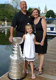 Claude Julien along with wife Karen and daughter Katrina sharing a moment with Lord Stanley outside the Westin Ottawa.