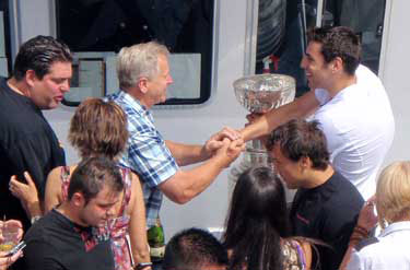 Milan Lucic and the Stanley Cup greeting family and guests aboard the 'Harbour Princess'.