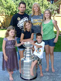 Shane Hnidy and family sharing a moment with the Stanley Cup at their home in Neepawa, MB.