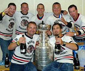 Shane Hnidy and with family and friends celebrating with the Stanley Cup in their old minor hockey dressing room at the Yellowhead Centre in Neepawa, MB.