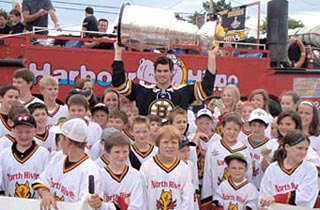 Adam McQuaid sharing his day with Lord Stanley and members of the North River Minor Hockey Association.