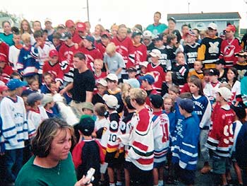 A blur of kids from local minor hockey organizations lined the streets of New Glasgow wearing their sweaters as a show of pride towards Colin White.