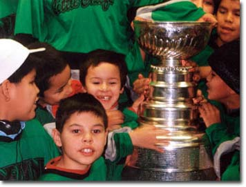 Children welcome the Stanley Cup.