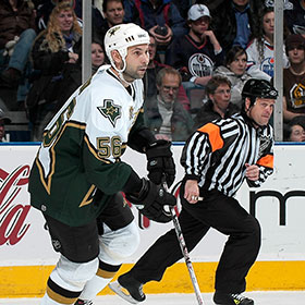Sergei Zubov carries the puck during a game on January 4, 2007 at Rexall Place in Edmonton, Alberta, Canada (Andy Devlin/HHOF).