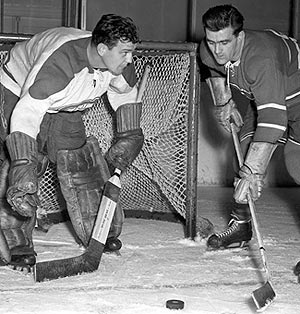 Bill Durnan wore a pair of special gloves that permitted him to catch with either hand while still holding his stick.