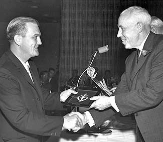 Bill Durnan is presented his Hockey Hall of Fame inductee plaque by former NHL President Clarence Campbell at the 1964 Induction Ceremony