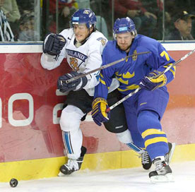 Swedens Niklas Kronwall 7 Battles With Finlands Teemu Selanne 8 For The Loose Puck During Gold Medal Game Action At 2006 Winter Olympic Games In