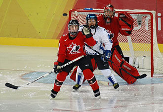 Game action between Canada and Finland at the 2006 Olympic Winter Games in Turin, Italy.