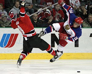 Canada's Mike Richards collides with Russia's Alexei Emelin during gold medal game action at the 2005 World Junior Championship in Fargo, North Dakota.