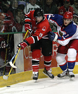 Canada's Andrew Ladd battles for the puck with Russia's Yakov Rylov during gold medal game action at the 2005 World Junior Championship in Fargo, North Dakota.
