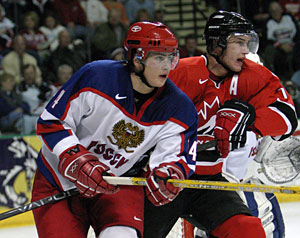 Canada's Jeff Carter battles with Russia's Dmitri Megalinski during gold medal game action at the 2005 World Junior Championship in Fargo, North Dakota.