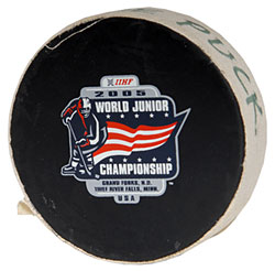 Final game puck scooped up by Canadian players following their 6-1 gold medal game victory over Russia at the 2005 World Junior Championship.