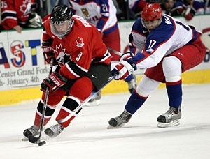 Canada's Sidney Crosby is checked by future teammate, Evgeni Malkin, during gold medal game action at the 2005 World Junior Championship in Fargo, North Dakota.