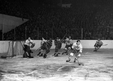 Toronto Maple Leaf Syl Apps in action against the Montreal Canadiens.